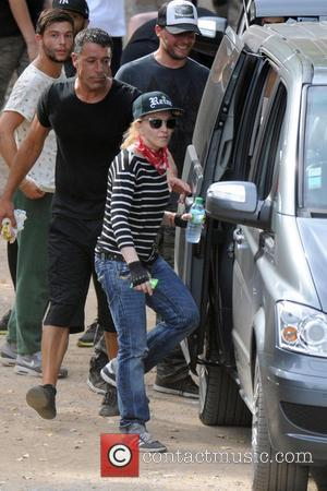 Madonna - Madonna enjoys a game of paintball with her boyfriend and children on a family holiday near Cannes in...