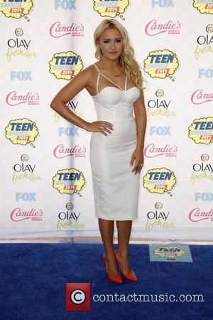 Emily Osment - Celebrities attend the 2014 Teen Choice Awards at The Shrine Auditorium - Arrivals - Los Angeles, California,...