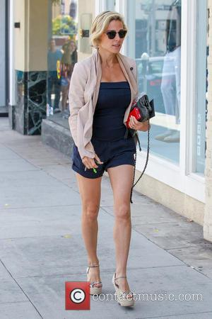 Elsa Pataky - Elsa Pataky looking lovely in a navy blue strapless top, matching shorts, a beige jacket and peep...