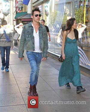 Jonathan Rhys Meyers - Actor Jonathan Rhys Meyers looking cool in his shades, white V-neck T-shirt, denim jacket, jeans and...