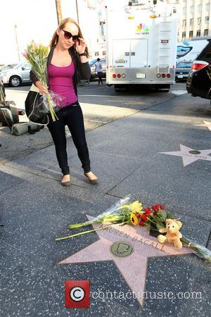 After the tragic loss of American screen and stage actress Lauren Bacall, fans leave flowers and momentos on her Hollywood...