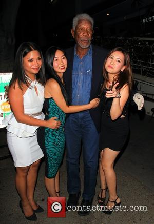 Morgan Freeman - Morgan Freeman posing with fans at Madeo Restaurant in Beverly Hills - Beverly Hills, California, United States...
