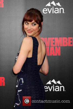 Olga Kurylenko - Los Angeles Premiere of 'The November Man' at TCL Chinese Theatre - Arrivals - Los Angeles, California,...