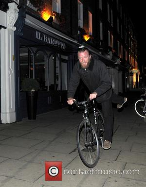 Guy Richie - A bearded Guy Richie rides his Brother bike home from Chiltern Firehouse - London, United Kingdom -...