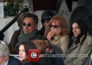 Bruce Springsteen and Patti Scialfa - Bruce Springsteen and his wife, Patti Scialfa, watch their daughter Jessica compete in the...
