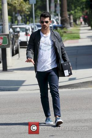 Joe Jonas - Joe Jonas goes shopping for Stampd shoes