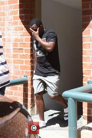 Sean Combs, Puff Daddy, Diddy and P Diddy - Sean Combs aka Puff Daddy seen leaving a building and covering...