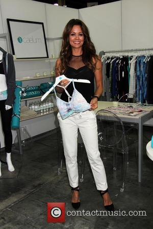 Brooke Burke-Charvet - Brooke Burke-Charvet promotes her new fitness clothing line at the 2014 MAGIC Convention held at Mandalay Bay...