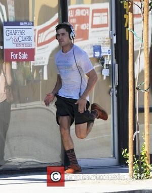 Zac Efron - Zac Efron works up a sweat on his first day on set of his new movie
