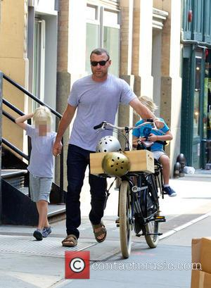 Liev Schreiber, Alexander Schreiber and Sasha Schreiber - Liev Schreiber out on his single three-seated bicycle in Soho with his...