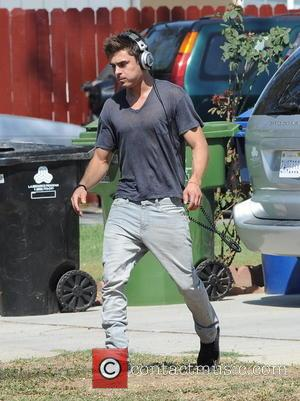 Zac Efron - Zac Efron shows off his biceps as he continues filming for his new movie 'We Are Your...