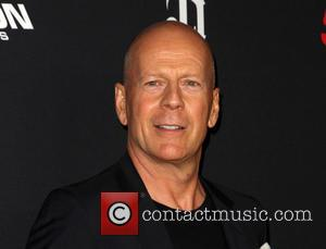 Bruce Willis - Various celebrities turned out for the premiere of 'Sin City: A Dame To Kill For' directed by...