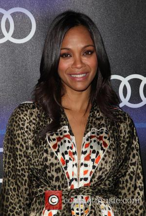 Watch Zoe Saldana Attempt To Pole Dance Pregnant In Funny Video