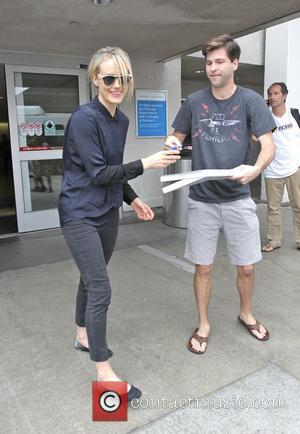 Taylor Schilling - Orange Is the New Black star Taylor Schilling arrives at Los Angeles International Airport (LAX), and signs...