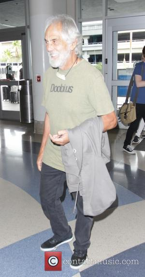 Tommy Chong - Tommy Chong, of Cheech & Chong, arrives at Los Angeles International Airport (LAX), and signs autographs for...