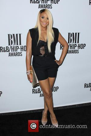 Tamar Braxton Takes Aim At Hair Loss Critics