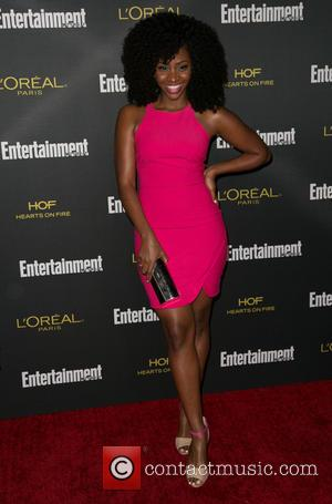 Teyonah Parris - 2014 Entertainment Weekly pre-Emmy party at Fig & Olive - Arrivals - Los Angeles, California, United States...