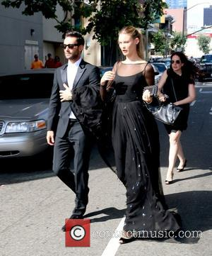 Adam Levine and Behati Prinsloo - 66th Primetime Emmy Awards held at The Nokia Theatre L.A. Live - Outside Arrivals...