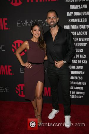 Emmanuelle Chriqui and Adrian Bellani - Showtime's 2014 Emmy Eve Soiree held at the Sunset Tower Hotel - Arrivals -...
