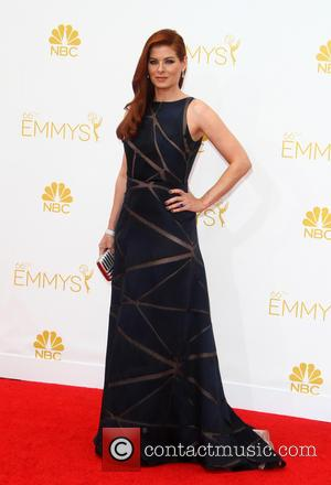 Debra Messing - 66th Primetime Emmy Awards at Nokia Theatre L.A. Live - Arrivals - Los Angeles, California, United States...
