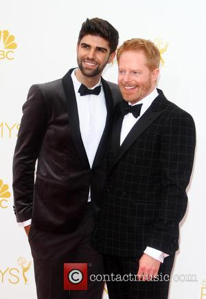 Jesse Tyler Ferguson and Justin Mikita - 66th Primetime Emmy Awards at Nokia Theatre L.A. Live - Arrivals - Los...