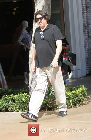 Alfred Molina - Alfred Molina goes shopping in Hollywood keeping his spectacles safe hanging on his shirt while he wears...
