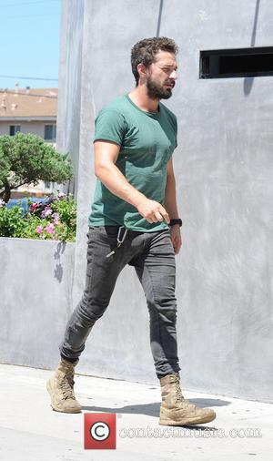 Shia LaBeouf - Shia LaBeouf wearing an old plain green t-shirt and black skinny jeans with scruffy boots goes out...
