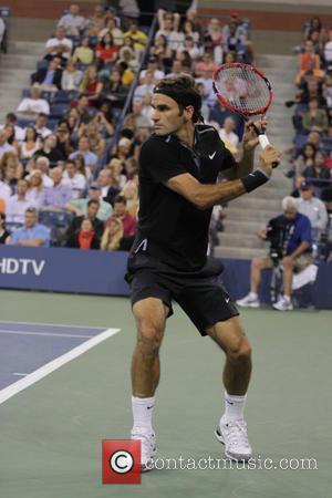 Roger Federer - A variety of stars including basketball legend Michael Jordan attend day 2 of the 2014 US Open...