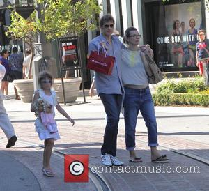 Milla Jovovich, Paul W.S. Anderson and Ever Anderson - Milla Jovovich and Paul W.S. Anderson take their daughter shopping at...