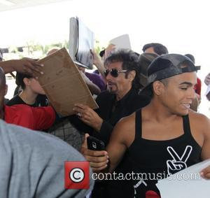 Al Pacino - While at Los Angeles International Airport (LAX), Al Pacino was mobbed by fans wanting autographs. The 'Godfather'...