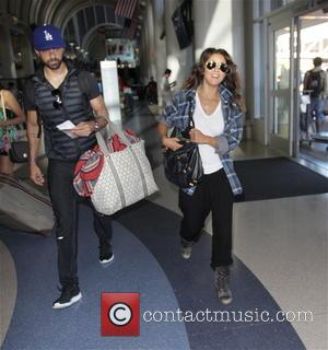 Emmanuelle Chriqui and Adrian Bellani - Emmanuelle Chriqui with her boyfriend Adrian Bellani depart from Los Angeles International Airport (LAX)...