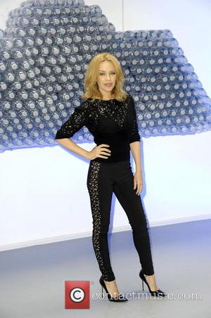 Kylie Minogue - Kylie Minogue attends a photocall to launch Glaceau Smartwater at The Dairy Art Centre - London, United...