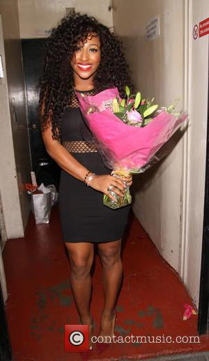 Alexandra Burke - An emotional Alexandra Burke poses for pictures with co-stars and fans at the stage door of the...