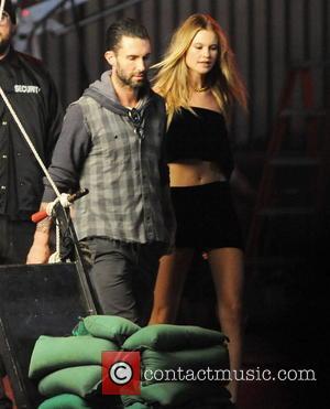 Adam Levine and Behati Prinsloo - Adam Levine and wife Behati Prinsloo film scenes for Maroon 5's next single 'Animals'...