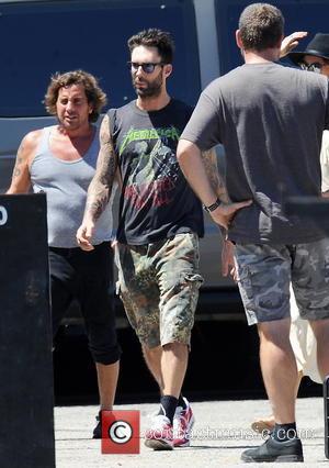 Adam Levine - Maroon 5 singer Adam Levine takes his new bride, Victoria's Secret model Behati Prinsloo, along for the...