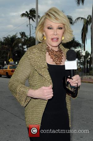 Joan Rivers - Joan Rivers appears on August 12, 2013 in Miami Beach, Florida. - Miami Beach, Florida, United States...