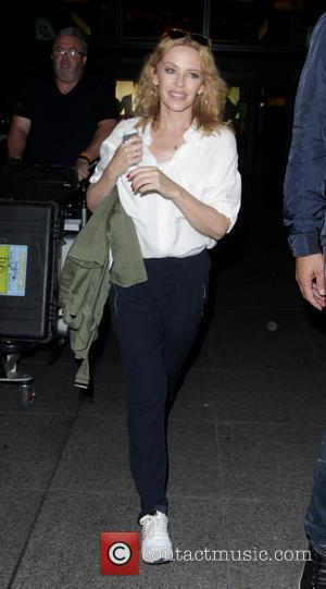 Kylie Minogue - Kylie Minogue at London Heathrow Airport - London, United Kingdom - Monday 1st September 2014