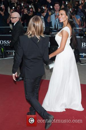 Iggy Pop and Nina Alu - GQ Men of the Year Awards held at the Royal Opera House - Arrivals...