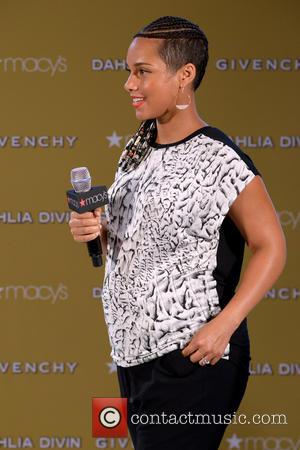 Alicia Keys - American R&B singer-songwriter Alicia Keys photgraphed wearing a black and white top with black pants and sporting...