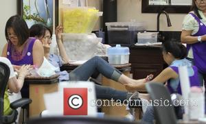 Katey Sagal - Katey Sagal flips the bird at photographers while getting a pedicure at a nail salon in Beverly...