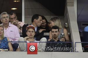 Ansel Elgort and Joe Jonas - Various Celebrities snapped on the 10th day of the 2014 US Open Tennis Championships...