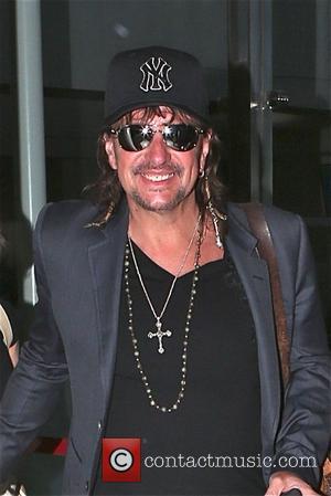 Richie Sambora - Richie Sambora and his girlfriend Orianthi Panagaris arrive at Los Angeles International Airport (LAX) - Los Angeles,...