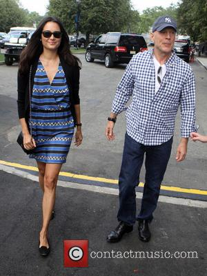 Bruce Willis and Emma Heming - A variety of celebrities were spotted during the 13th day of the 2014 US...