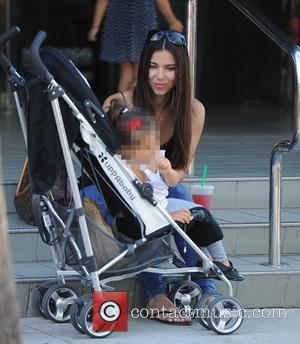 Roselyn Sanchez - Roselyn Sanchez enjoys a day with her family at the Farmers Market - Los Angeles, California, United...