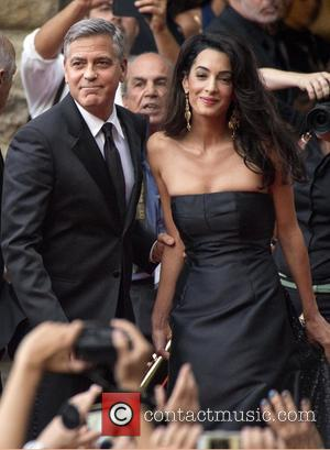 George Clooney and Amal Alamuddin - Celebrity Fight Night benefiting The Andrea Bocelli Foundation and The Muhammad Ali Parkinson Center...
