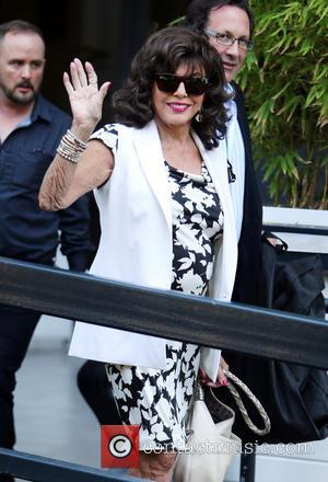 Joan Collins Donates Designer Clothes To Charity