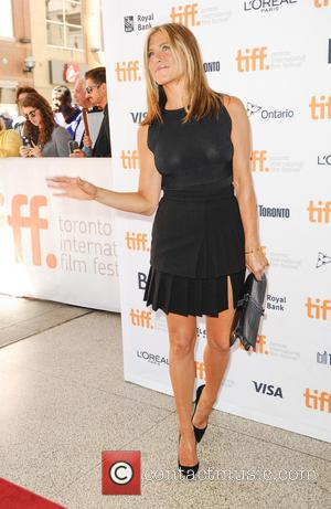 Jennifer Aniston - Stars of new film 'Cake' Jennifer Aniston and Sam Worthington photographed at the 2014 Toronto International Film...
