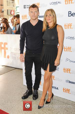 Jennifer Aniston and Sam Worthington - Stars of new film 'Cake' Jennifer Aniston and Sam Worthington photographed at the 2014...