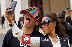 Perez Hilton and June Ambrose - Mercedes-Benz New York Fashion Week Spring 2015 - Celebrity sightings at Lincoln Center -...