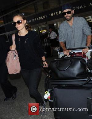 Natalie Portman and Benjamin Millepied - Natalie Portman and husband Benjamin Millepied at Los Angeles International Airport (LAX) - Los...